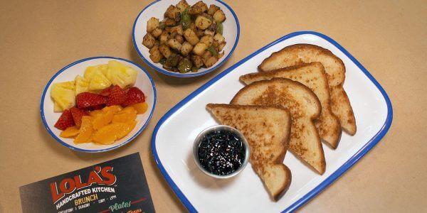 Breakfast potatoes, fruit salad, toast & jam